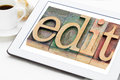 Edit word in wood type blogging concept letterpress blocks on a digital tablet with a cup of coffee Stock Images