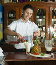 Editorial bartender mixing drink in restaurant Corn Island Nicar Royalty Free Stock Photo