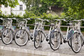 Editorial bicycle rental ljubljana slovenia may bicycles for rent in rack are seen in along the ljubljanica river on may the bike Royalty Free Stock Image