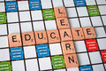Educate and learn the words on a scrabble board Royalty Free Stock Photo