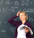 Education - Attractive female teacher standing Stock Images