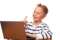 Education a boy surfing on laptop and has a idea Stock Photos