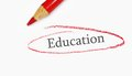 Education circle red pencil closeup and text circled Royalty Free Stock Image