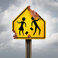 Education decline and neglected school problems concept as a rusted student crossing traffic sign as a symbol of negligence in Royalty Free Stock Photography