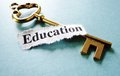 Education key closeup of a and paper note with text Royalty Free Stock Photo