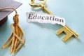 Education key note on a golden with graduation cap Royalty Free Stock Images