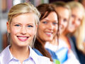 Education - Line of students smiling happily Stock Photo