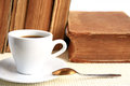 Education old book and coffee cup on a light background Royalty Free Stock Photos