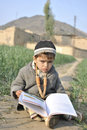 Education in pakisan one small kid the bright future of fata pakistan has been compelled by the remoteness of schools to opened Stock Image