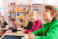 Education pupils at school doing homework primary or elementary their or having a test Royalty Free Stock Image