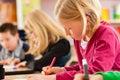 Education - Pupils at school doing homework Royalty Free Stock Photo