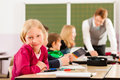 Education pupils and teacher learning at school elementary or primary in the classroom Stock Image