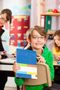 Education pupils and teacher learning at school elementary or primary in the classroom Royalty Free Stock Photo