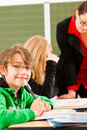 Education pupils and teacher learning at school elementary or primary in the classroom Stock Images