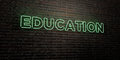 EDUCATION -Realistic Neon Sign on Brick Wall background - 3D rendered royalty free stock image Royalty Free Stock Photo