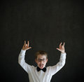 Education rocks boy dressed up as businessman on blackboard background business man teacher or school student pointing Royalty Free Stock Photography