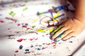 Education, school, art and painitng concept - little girl showing painted hands Royalty Free Stock Photo