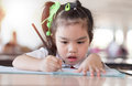 Education and school concept asian (japan, chinese, korea)pretty girl hold a book and reading Royalty Free Stock Photo