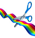 Education start or arts and crafts school launch concept with children scissors cutting a silk rainbow colored ribbon as a Royalty Free Stock Photos