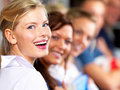 Education - Students smiling happily in a line Royalty Free Stock Photos