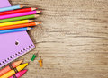 Education supplies on old wooden background colorful pencils notebook crayons and push pins back to school Stock Images