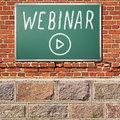 Education theme. Ancient brick wall with WEBINAR title on a chal Royalty Free Stock Photo