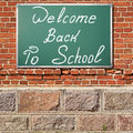 Education theme. Ancient brick wall with Welcom back to school t Royalty Free Stock Photo