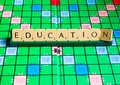 Education word on scrabble for use with designs Royalty Free Stock Photo