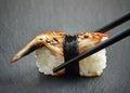Eel sushi on black background Stock Photos