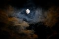 Eery full moonlit twilight catching the moon through a break of cloud cover in the northwest Royalty Free Stock Photos