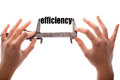 Efficiency color horizontal shot of two hands holding a caliper and measuring the word Royalty Free Stock Photo
