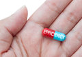 Efficiency concept hand holding pill over a white background Royalty Free Stock Images