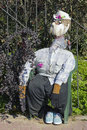 Effigy the handmade naive dummy is dressed in clothes of the peasant and protects a kitchen garden from crows Stock Images