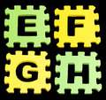 EFGH Alphabet learning blocks isolated Black Royalty Free Stock Photo