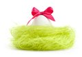 Egg with bow is in the nest of sisal filler Stock Photos