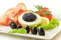 Egg with caviar and garnish Royalty Free Stock Photography