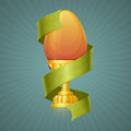 Egg cup with ribbon easter in a gold on a dark background rays Stock Photo
