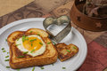 Egg dipping toast rich decadent bread toasted to perfection with a heart cut out where an is cooked just right for Stock Images