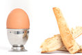 Egg in an eggcup close up of one whole with toast Royalty Free Stock Photo