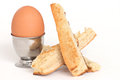 Egg in an eggcup close up of one whole with toast Royalty Free Stock Photography