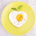 Egg heart shape plate of Stock Photo