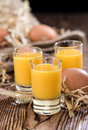 Egg liqueur fresh made on vintage wooden background Stock Photo