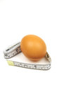 Egg and measuring tape Stock Photography