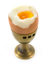Egg in old brass cup Royalty Free Stock Photo