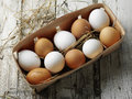 Egg s box raw chicken eggs in the wooden Royalty Free Stock Images