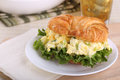 Egg salad on croissant roll with lettuce a Stock Image