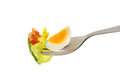 Egg and salad on fork Royalty Free Stock Photo