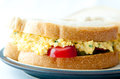 Egg salad sandwich with sliced tomatoes and cucumber on sourdoug Royalty Free Stock Photo