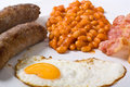 Egg, sausages, beans and bacon Royalty Free Stock Photos