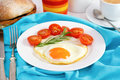 Egg with tomato on the plate with bread Stock Image